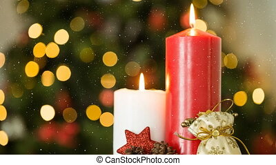 Falling snow and Christmas candles decoration