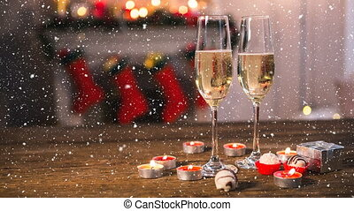 Falling snow with Christmas champagne