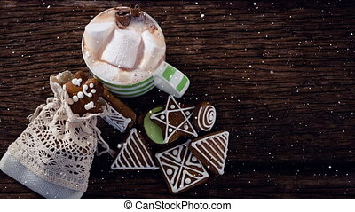 Falling snow with Christmas hot chocolate and cookies