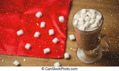 Falling snow with Christmas hot chocolate
