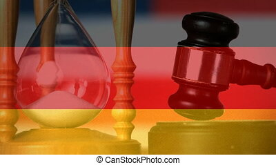 Digital composite of Germany flag and hourglass. Gavel banging on sounding block 4k
