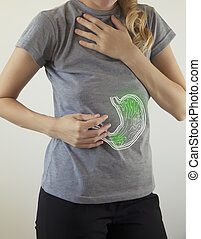Digital composite of highlighted stomach of woman with infection