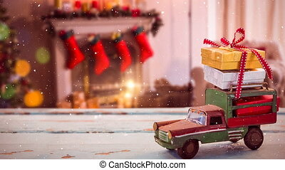Model car with christmas presents on its roof in a living room decorated for christmas combined with
