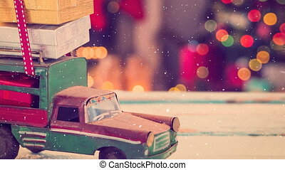 Model car with presents on its roof combined with falling snow
