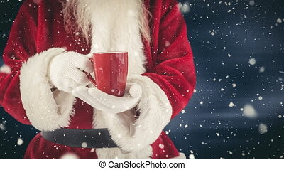 Santa clause holding a hot drink combined with falling snow