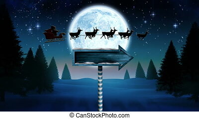 Digital composite of Santa in sleigh with reindeer flying and arrow sign over night forest with moon