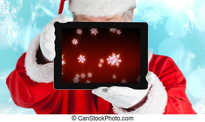 Santa using tablet with snowflakes