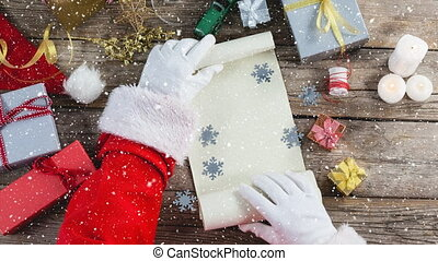 Video composition with snow over desk with santa revealing paper roll