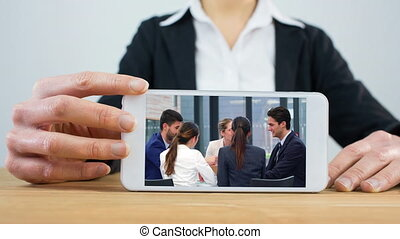 Woman using phone with business meeting