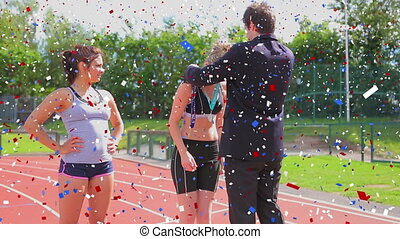 Animation of colourful confetti falling at the end of a race with two female athletes standing and a male judge awarding the winner with a medal in the background