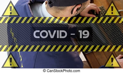 Digital composite video of Covid-19 text with yellow warning...