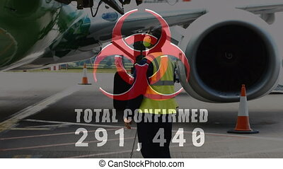 Animation of a hazard sign with Total Confirmed number rising over an airplane. Coronavirus Covid-19 pandemic concept digital composite