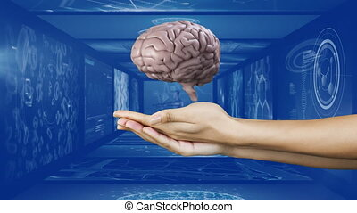Digital composite video of human brain spinning over cupped hands against screens of medical data processing on blue background. medical research and technology concept