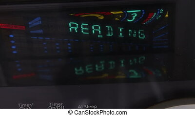 Digital display of Hi-Fi stereo system close up view