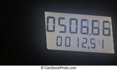 Digital display with changing numbers. Digits run on the ...