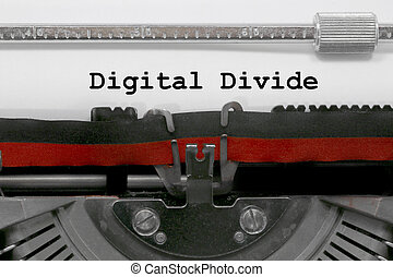 Digital Divide text by the old typewriter on white paper
