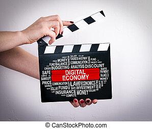 Digital Economy Concept. Female hands holding movie clapper