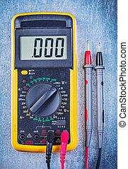 Digital electrical tester on metallic surface top view