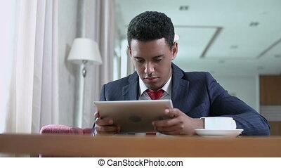 Digital Era - Low angle shot of businessman with digital...
