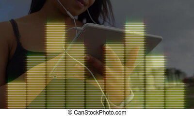 Digital interface of music equalizer against woman using ...