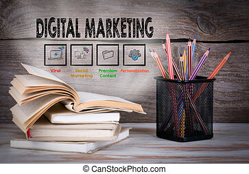 Digital Marketing. Stack of books and pencils on the wooden table.