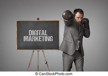 Digital marketing text on blackboard with businessman