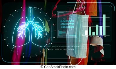 digital meter monitor radar scanning deteced covid virus in lung and mask on clothes line