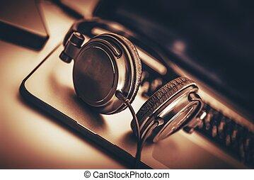Digital Music Headphone on the Computer. Closeup Photo.