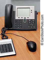 Digital phone on office table