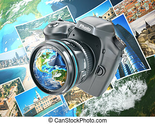 Digital photo camera on background from earth and photographs.