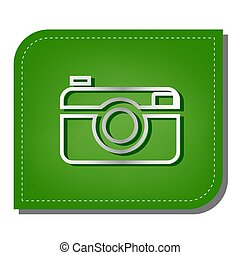 Digital photo camera sign. Silver gradient line icon with dark green shadow at ecological patched green leaf.