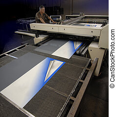 Digital Screen Printer - A technician working on a wide ...