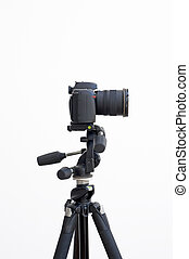 Digital SLR camera on a tripod isolated on white