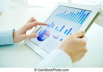 Digital statistics - Business person analyzing financial...