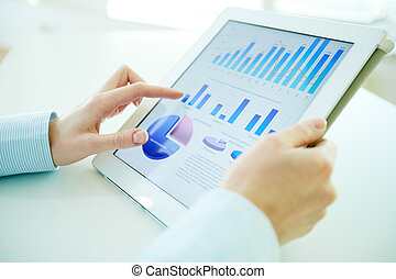 Digital statistics - Business person analyzing financial...