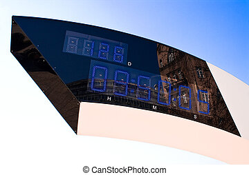 Digital street clock over blue sky