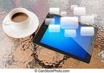 Digital tablet and cup of coffee on work table