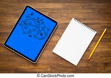 Digital tablet computer on wooden background with social ...