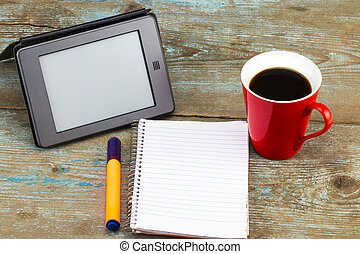 Digital Tablet Computer with Blank White Screen as Copy Space and a cup of coffee on wooden background