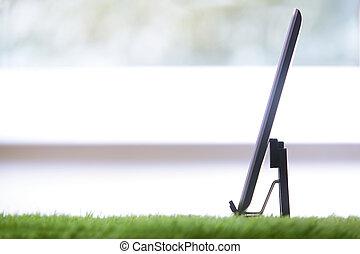 Digital tablet in a grass office