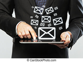 email icon - digital tablet in hand and email icon