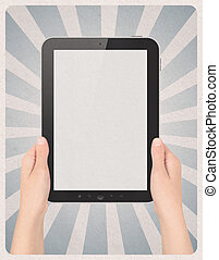 Digital tablet in hands on retro background