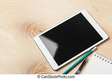 Digital tablet on office table. Creative photo.