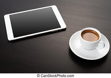 Digital tablet on office table.