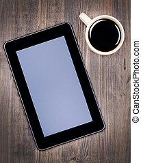 Digital tablet pc and coffee cup
