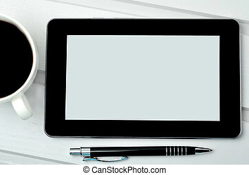 Digital tablet pc with coffee cup and pen