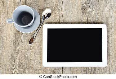 digital tablet with a cup of coffee