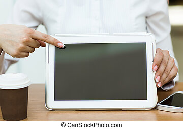 Digital tablet with blank screen in coffee shop cafe