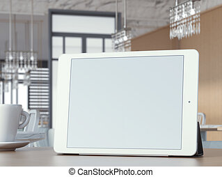 Digital tablet with blank screen on cafe table