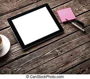 Digital tablet with note paper and cup of coffee